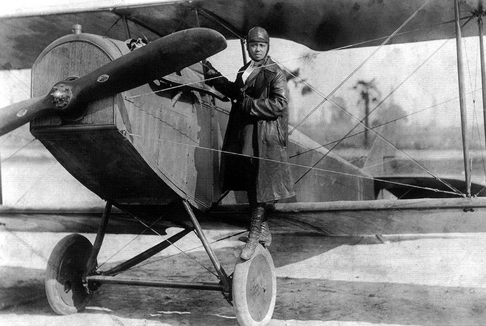 Bessie Coleman and her plane.