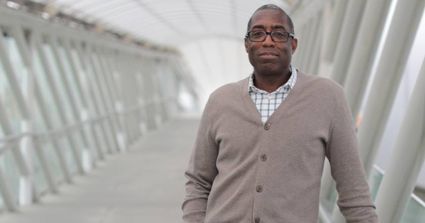 A photograph of Ron Limes on the Museum's pedestrian bridge.