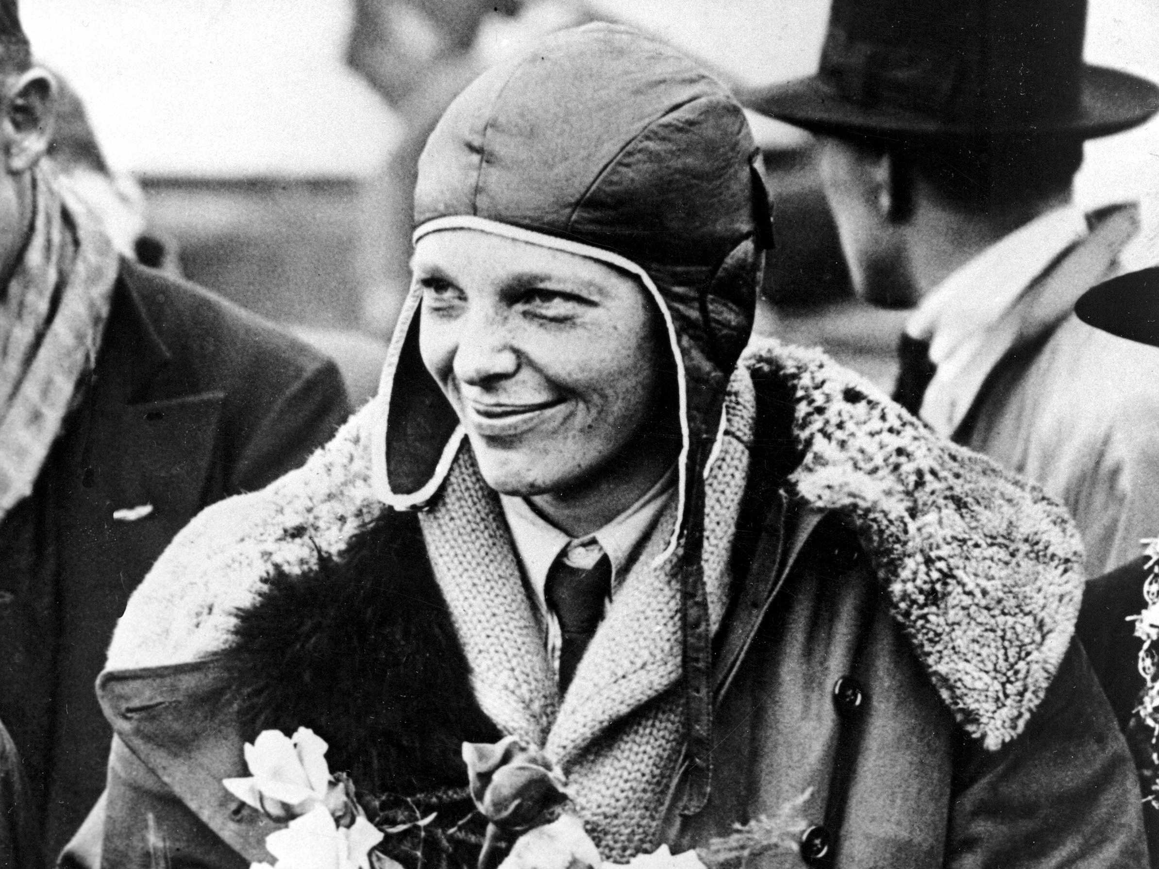 american-aviatrix-amelia-earhart-poses-with-flowers-as-she-arrives-in-southampton-england-after-her-transatlantic-flight-on-the-friendship-from-burry-point-wales-on-june-26-1928